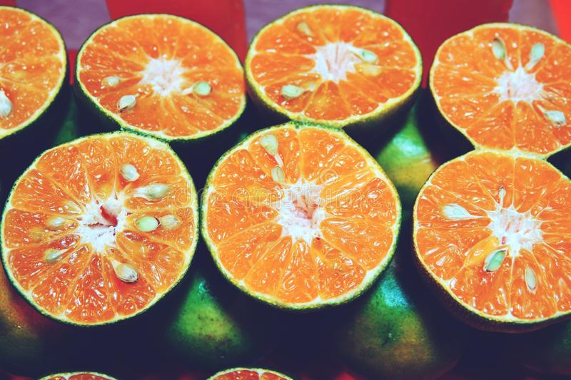 Closeup of cut oranges on a market stock images