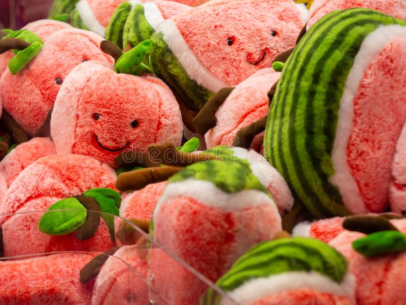 Cute smiley face of watermelon dolls in an Arcade Claw Crane Game. stock photo