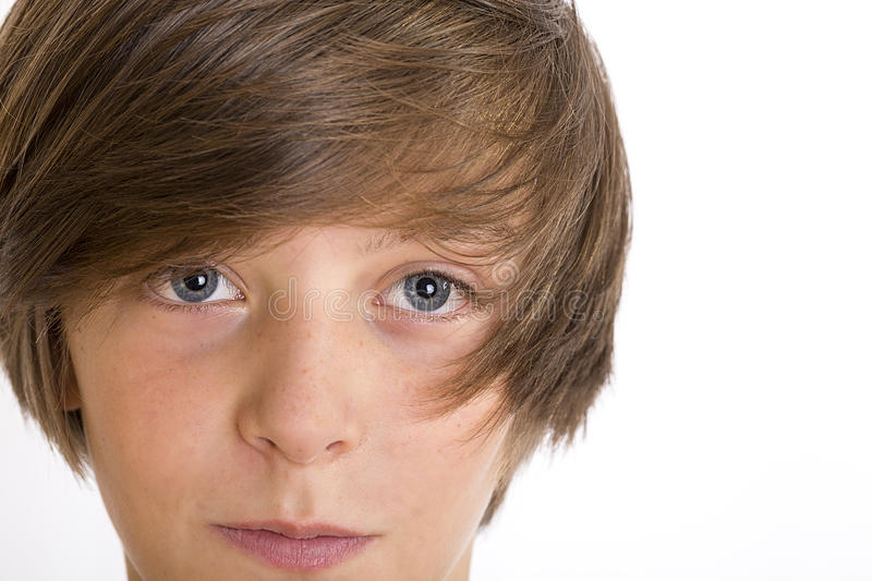 Closeup of a cute teenage boy smiling into the camera royalty free stock images