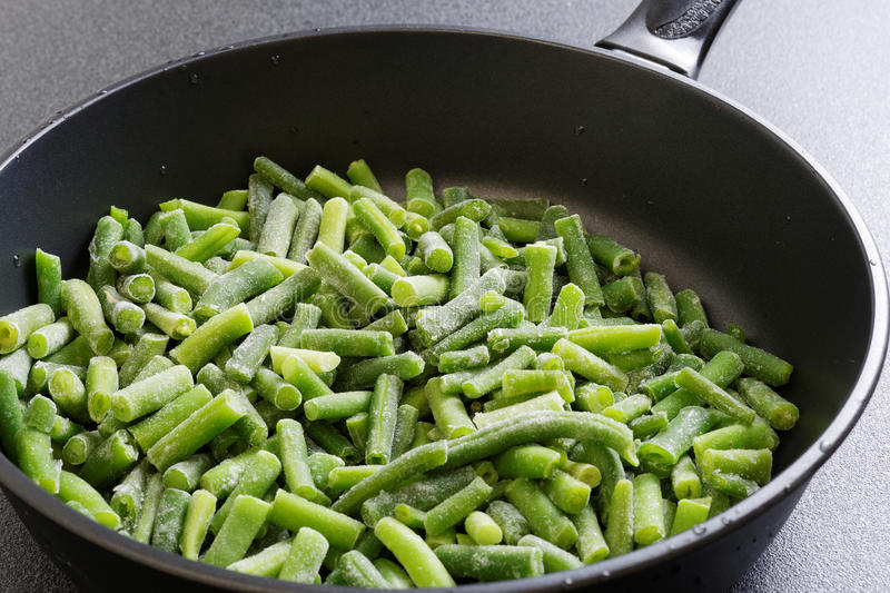Closeup cuted green french bean on the pan. Ready for frying stock photography