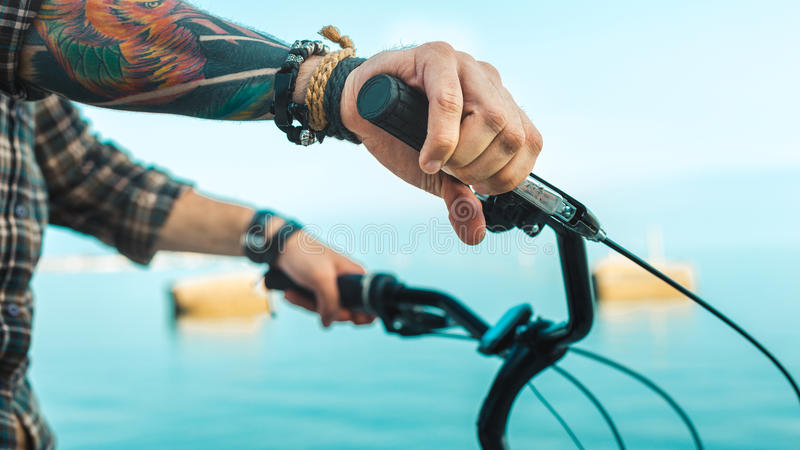 Download Closeup Of A Cyclist Hand On Bike Handlebars, Holiday Activity Transportation Concept Stock Image - Image: 96923753