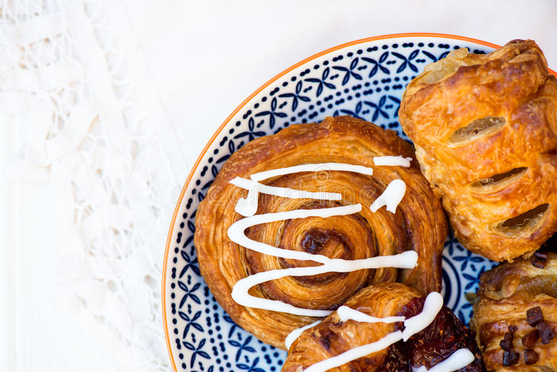 Closeup of Danish Assosted Pastries. Closeup of Selection of Assorted Danish Pastries on the Bright Plate stock photos