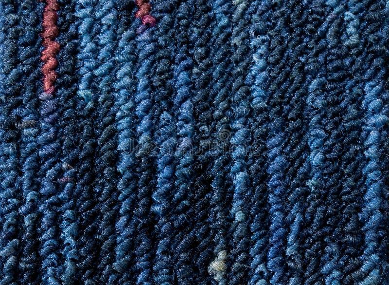 Closeup dark blue,navy blue carpet sample texture backdrop. Dark blue,blue,red with grey strip line pattern design,carpet for deco royalty free stock photos