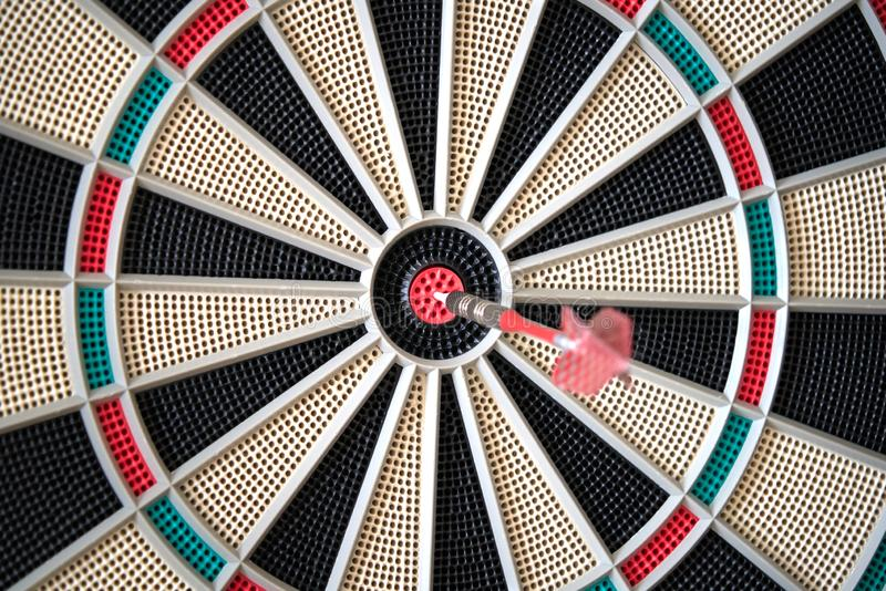 Closeup of dart board with dart in the bulls eyes stock image