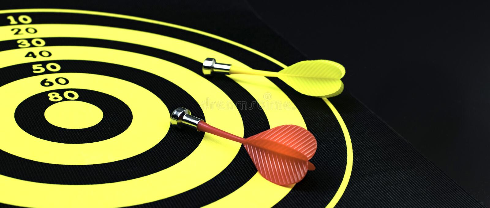 Darts board with two magnet arrows . royalty free stock images