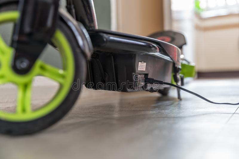 Closeup day view electric scooter charging up.  stock image