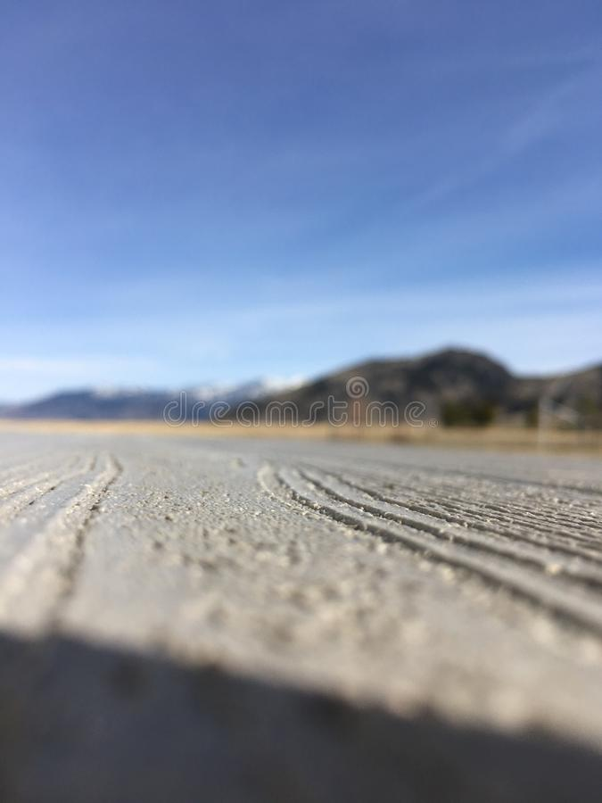 Closeup of Deck with Mountains in Background stock photo