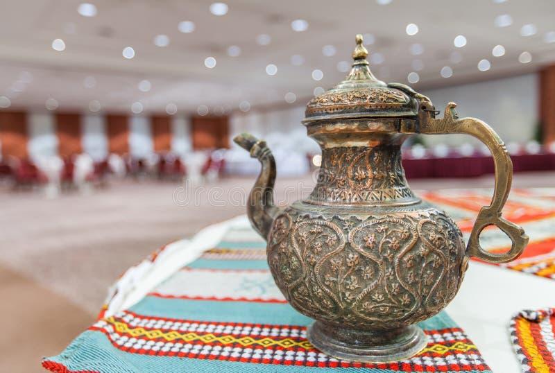 Closeup of decorative antique Arabian teapot stock photography