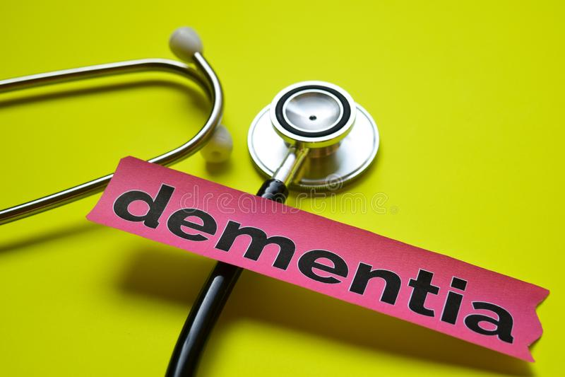 Closeup dementia with stethoscope concept inspiration on yellow background stock image