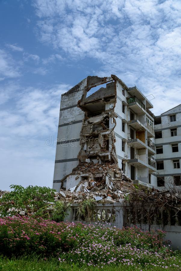 Closeup of a demolished appartment. Closeup of a ruins of a demolished appartment with blue sky and white clouds stock photos