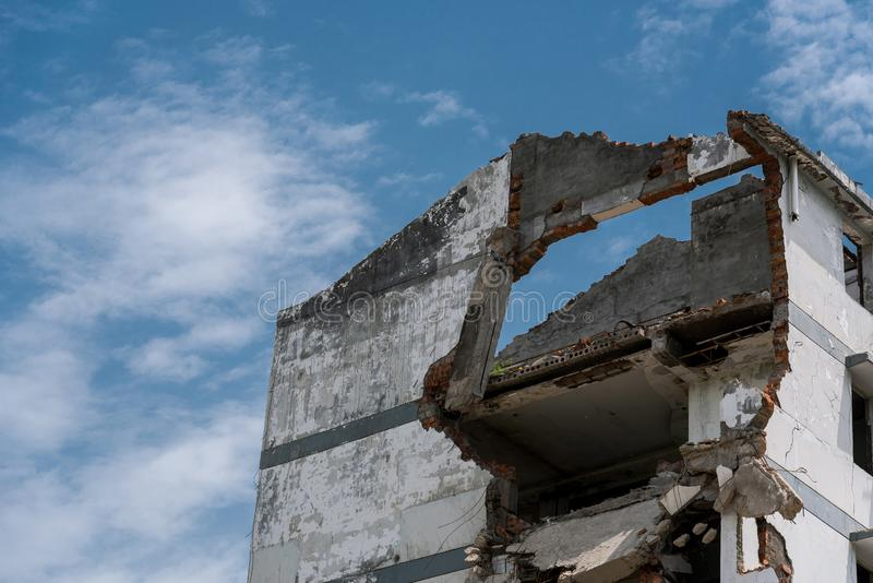 Closeup of a demolished appartment. Closeup of a ruins of a demolished appartment with blue sky and white clouds stock photography