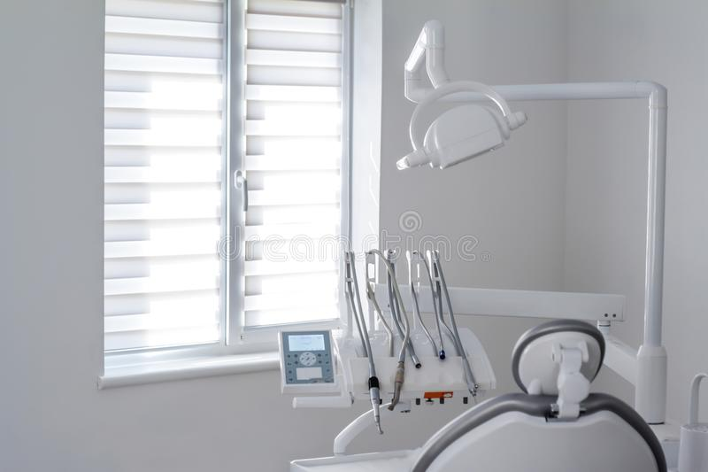 Closeup of dental instruments and equipment in empty dentists office stock photo