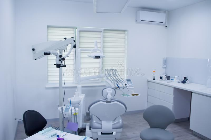 Closeup of dental instruments and equipment in empty dentists office royalty free stock photo