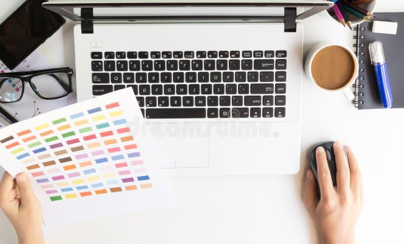 Closeup designer use laptop on desk royalty free stock images