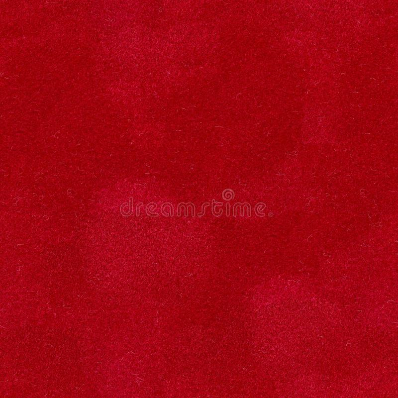 Closeup detail of aged red velvet  background. Seamless square texture, tile ready. High quality image stock photography