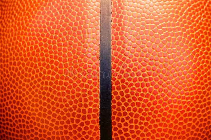 Closeup detail of basketball ball texture background.  royalty free stock image