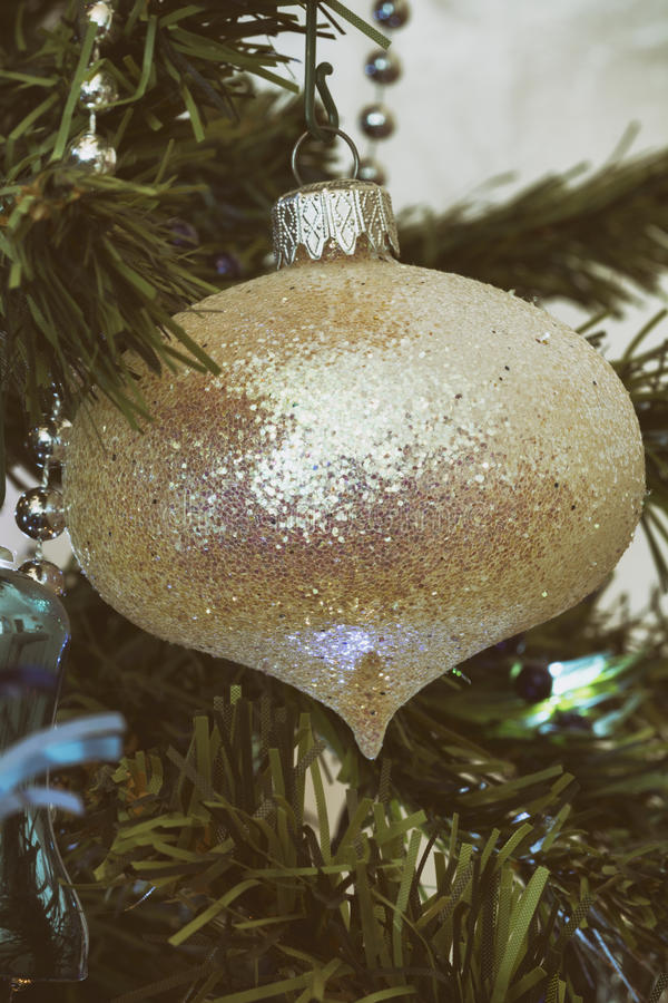 Closeup detail of christmas tree with decorations analog camera style. Detail of christmas tree with decorations style analog camera, warm colors and vignetting royalty free stock photos