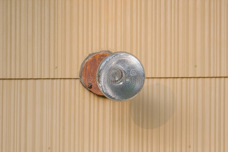 Closeup detail of exterior flood light bulb on house royalty free stock photography
