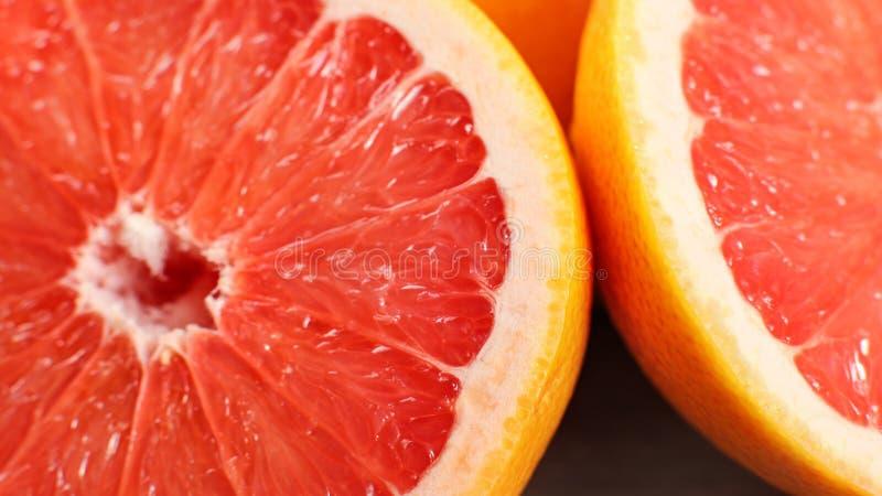 Closeup detail of pink grapefruit cut in half royalty free stock photos