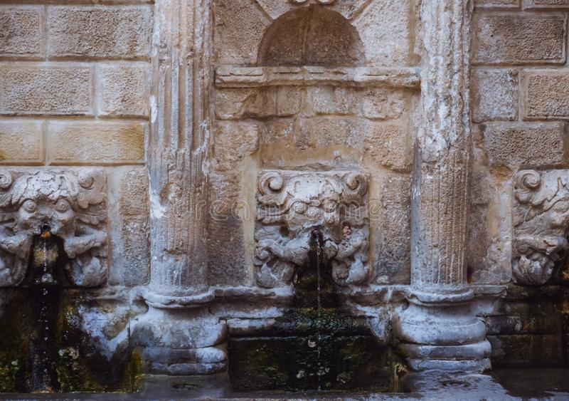 Closeup detail of the stone sculptures on a ancient Roman fountain in Rethymno city - Crete, Greece stock photo