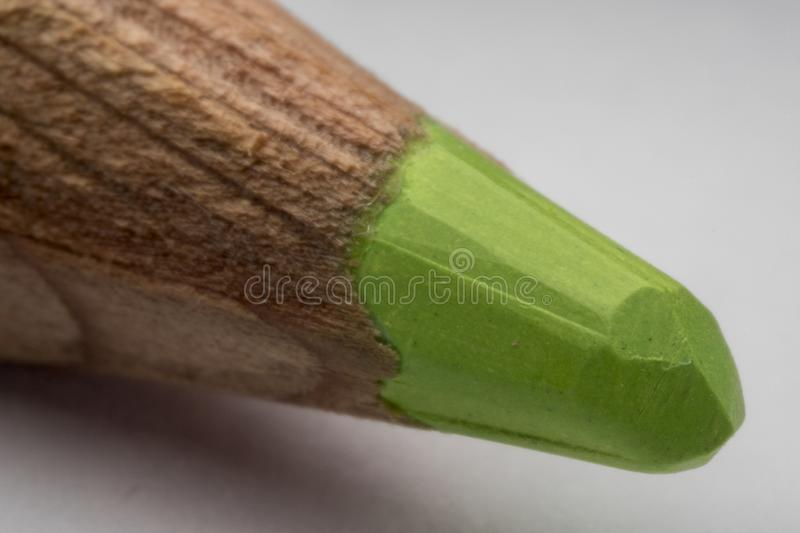 Closeup detail of the tip of a green pencil royalty free stock photos