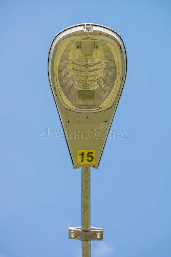 Closeup detailed street lamp / street light with blue sky in background royalty free stock image