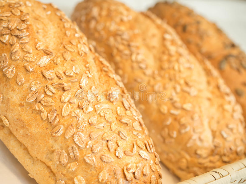 Closeup details of fresh baked Avena Vital Bread with oat flakes stock photo