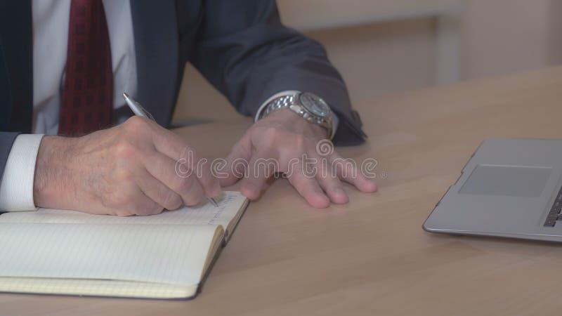 Close up businessman handwriting. stock images