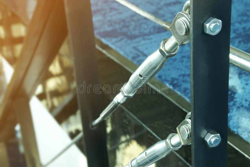 Closeup Details of Metal Hardware Parts of Stair Cable Railing System royalty free stock image