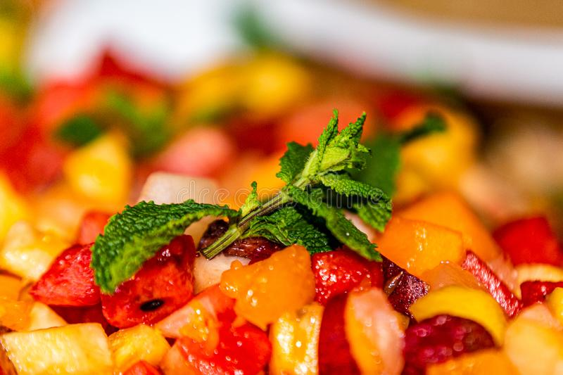 Closeup diet-fresh tasty mix fruit salad with mint leaves royalty free stock image