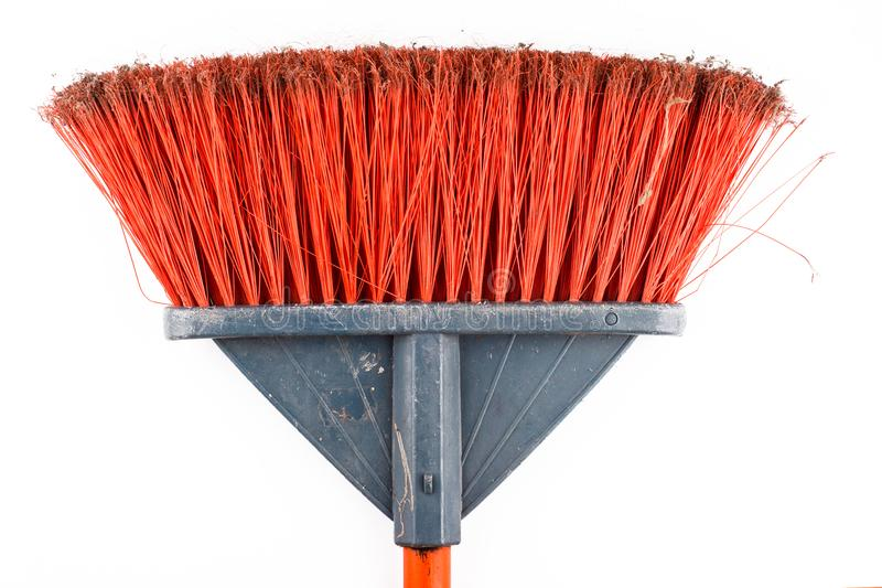 Closeup of dirty sweeping broom on white background. Top view closeup of red plastic dirty sweeping broom isolated on white background royalty free stock photos