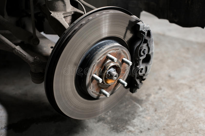 Closeup disc brake of the vehicle for repair. royalty free stock images
