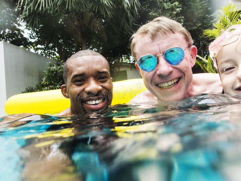 Closeup of diverse people enjoying the pool together stock photo