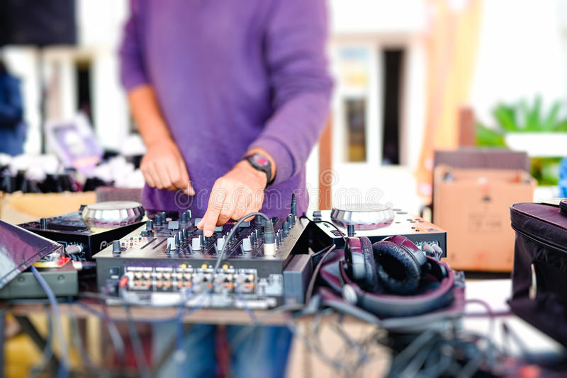 Closeup of dj's hands mixing audio tracks with stock photography