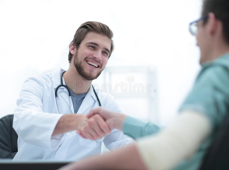 Doctor welcoming a patient in his studio royalty free stock photography