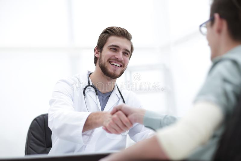 Doctor welcoming a patient in his studio stock photo