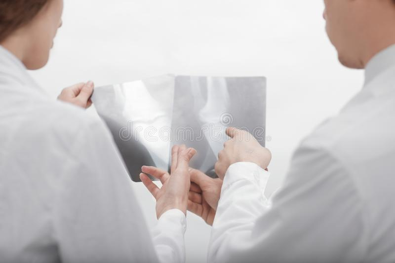 Doctors are diagnosticians discussing x ray of patient. Closeup.doctors are diagnosticians discussing x ray of patient royalty free stock photo