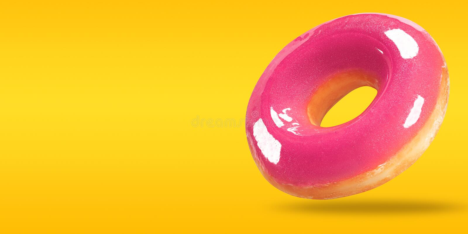 Closeup donut with copy space on yellow and orange background. Summer sweet food concept.  royalty free stock photo
