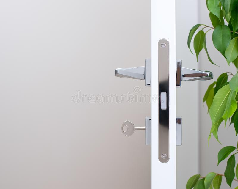 Closeup of the door lock with the key. Modern chrome handles vector illustration