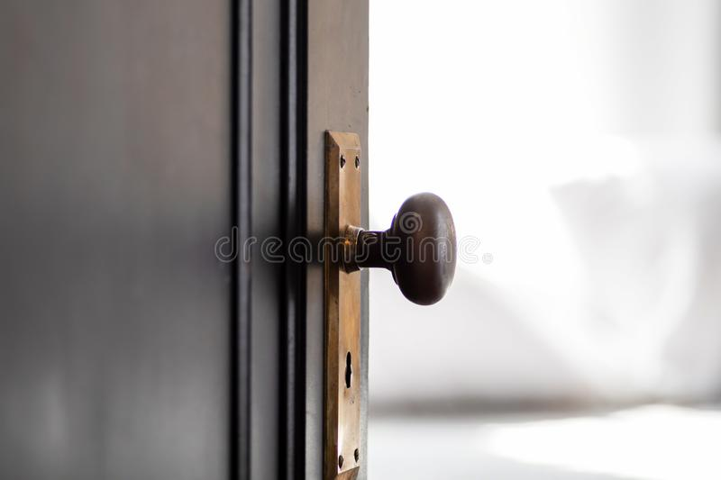 Closeup of doorknob in old house. Closeup of doorknob and keyhole in old home - vintage detail royalty free stock images