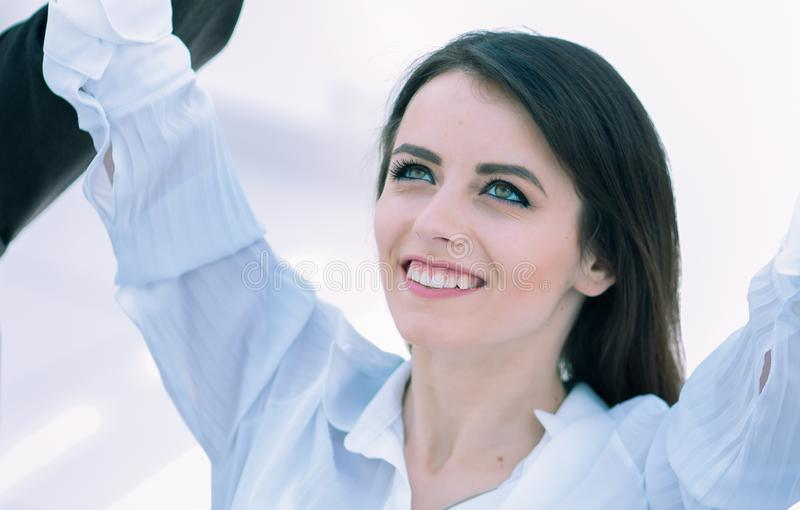 Closeup.dreaming business woman and business team sitting at Desk stock images
