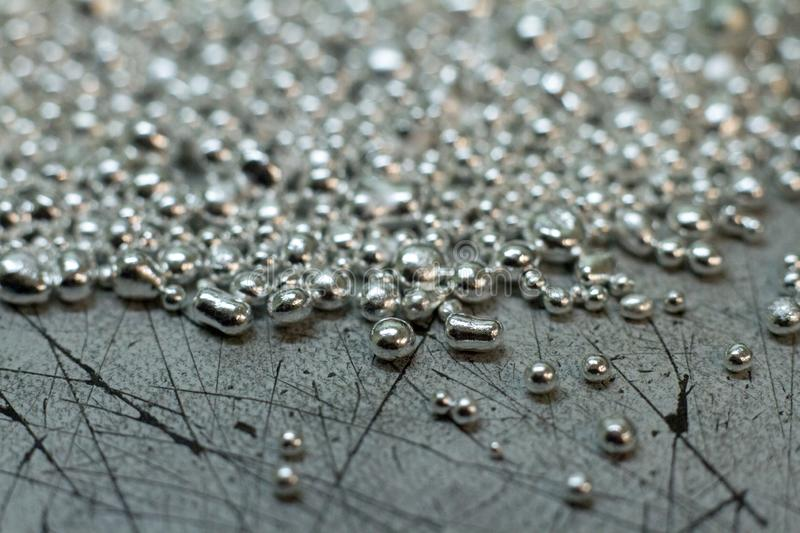 Closeup of a drop of silver for the manufacture of handmade jewelry. Jewelry silver royalty free stock images