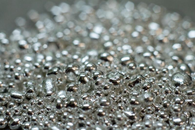 Closeup of a drop of silver for the manufacture of handmade jewelry. Jewelry silver stock images