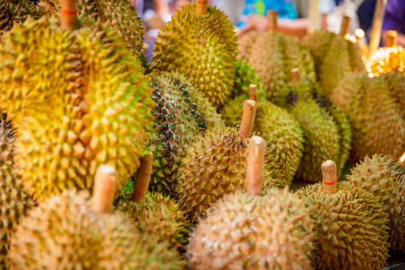 Durian Fruits For Sale On Market Stall. Closeup of durian fruits for sale on market stall in Thailand royalty free stock image