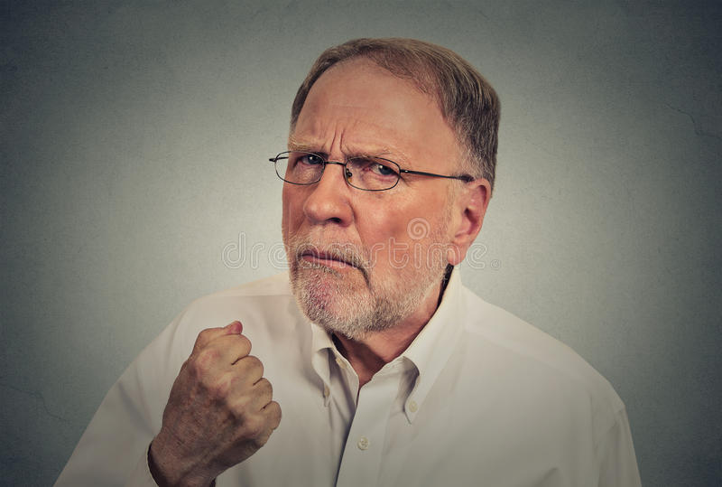 Closeup elderly angry man stock images