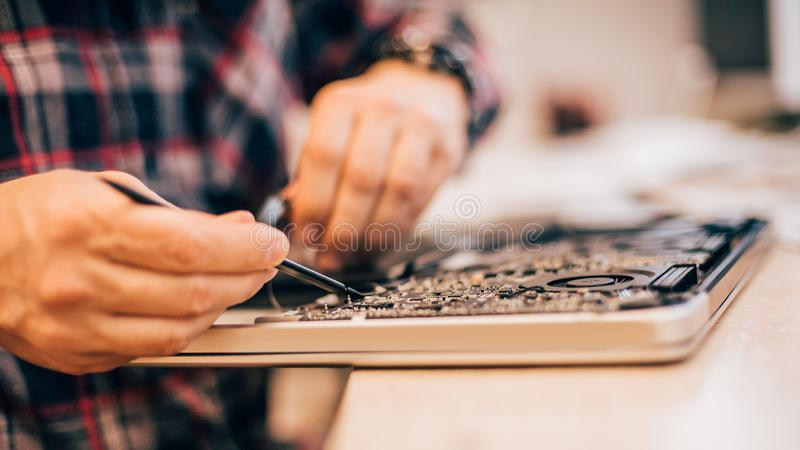 Electrician engineer technician repair faulty laptop computer in electr service royalty free stock photography