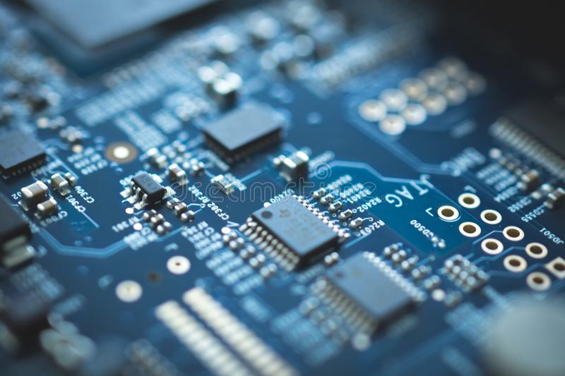 closeup of electronic device circuit board with processor background blue texture technology computer serve cpu motherboard chip stock image