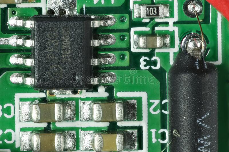 Closeup of  Electronic Printed Circuit Board with Lots of Surface Mounted Components. royalty free stock photo
