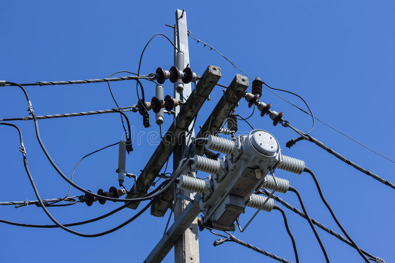 Closeup Eletricity line and electricity post. Wtih blue sky background stock images