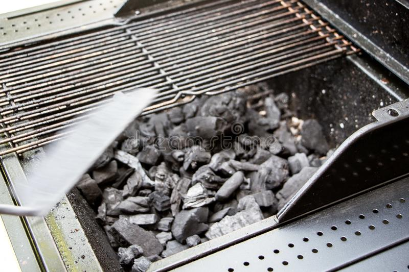 Closeup of embers of charcoal burning inside a barbecue stock photo
